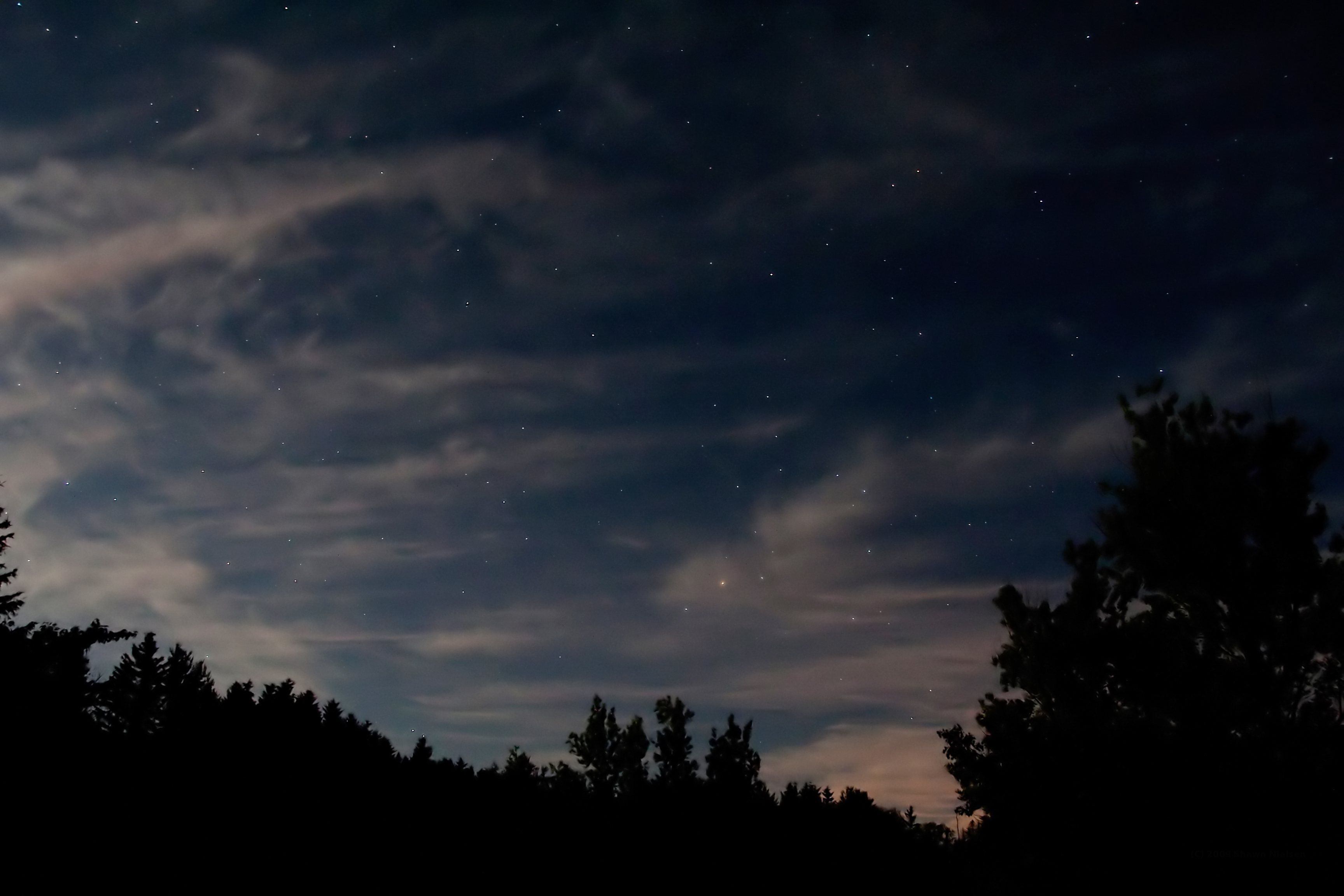 Whispy Moon clouds and the summer star Antares. Shawn Nielsen, 2009