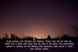 Light pollution dom emanates into the night sky from the cities of Kitchener and Waterloo in Ontario, Canada